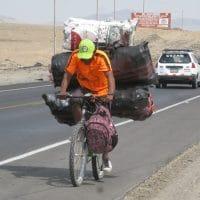 Peru Cyclist With Heavy Load